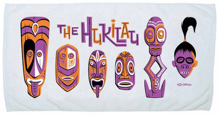 The beach towel features artwork by Shag that pays homage to some of the distinctive Tikis (and shrunken head) at The Mai-Kai.