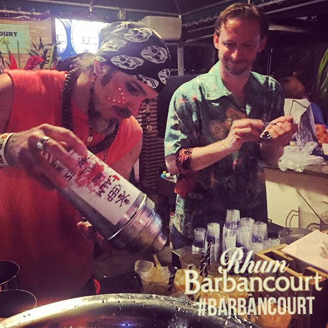 Brian Miller (left) mixes up his signature Haitian Frolic cocktail while representing Rhum Barbancourt at The Art of Tiki: A Cocktail Showdown at the South Beach Wine & Food Festival on Feb. 26. At right is Barbancourt mixologist Zach Lynch from the Ice Plant in St. Augustine