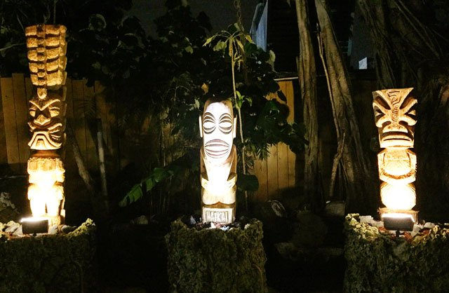 A trio of newly installed tikis greets guests in The Mai-Kai's porte-cochère