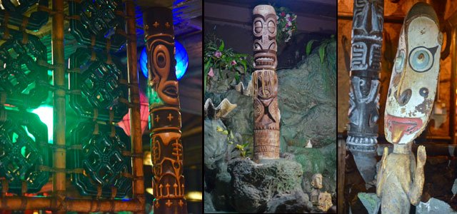 "The Mai-Kai's lush gardens contain a variety of Tiki carvings, new and old. In the area behind the stage for the Polynesian Islander Revue, a recent carving by <a href=""http://www.slammie.com/atomicgrog/blog/2015/04/30/the-week-in-tiki-april-27-may-3-2015-trader-sams-grog-grotto-grand-opening/#artist"">Dave ""Basement Kahuna"" Wolfe</a> (center) shares space with a historic carving (right) that inspired The Hukilau's <a href=""http://www.slammie.com/atomicgrog/blog/wp-content/uploads/2016/05/The-Hukilau-2016-official-mug-300x300.jpg"" target=""new"">official 2016 event mug.</a> (Photos by Kevin Upthegrove)"
