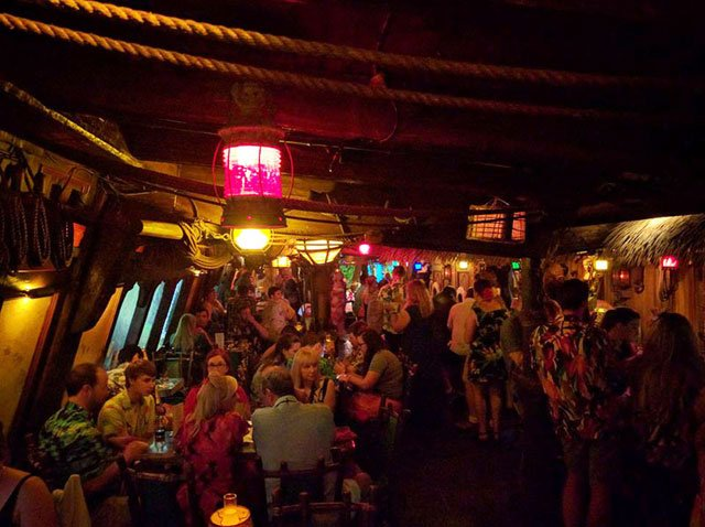 The Hukilau's opening-night villagers enjoy The Molokai lounge, which is styled after the legendary British merchant ship HMS Bounty. (Photo by Barron Elam)