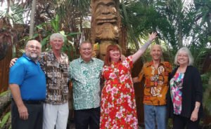 "The Mai-Kai's owner, Dave Levy (third from left), is joined on May 22 by most of those responsible for making King Kai possible (from left): Pete Ginn, Lonnie Dryden, Christie ""Tiki Kiliki"" White, Will Anders, and Virginia Decker."