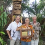 Fort Lauderdale carver Will Anders shows off the award he received on May 22 for creating King Kai, flanked by two others who were essential in pulling off the installation: Tom Fowner (left) and Lonnie Dryden.