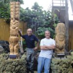Fort Lauderdale artists Will Anders (left) and Tom Fowner installed their new Tikis at The Mai-Kai on May 28.