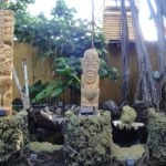 The Mai-Kai's newest Tikis - carved by Will Anders, Tom Fowner and Jeff Chouinard - can be seen on the right as you drive up to the valet stand.