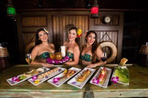 Waitresses in The Molokai bar show off some of the new dishes on the tapas and sushi menu from chef Mark Rivera. (Facebook photo)