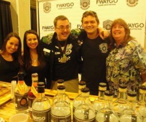 Fwaygo Rum reps, including label owner Avi Aisenberg (second from right), with Miami Rum Festival organizers Robin Burr (right) and son Robert V. Burr on April 17. (Photo by Hurricane Hayward)