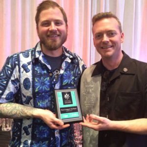 Bartender Steve Anderson (left) and general manager Shannon Smith show off Porco Lounge & Tiki Room's 2016 Silver Spoon Award for best cocktails in Cleveland. (Facebook photo)