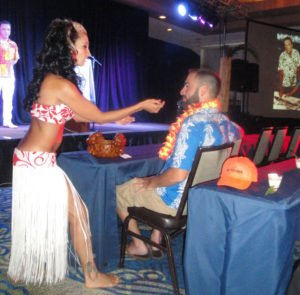 "Marina the Fire Eating Mermaid performs the Mystery Drink dance for a lucky villager at Pier 66 during Tim ""Swanky"" Glazner's symposium, ""The Mai-Kai: History, Mystery and Adventure"" at The Hukilau in June 2016. (Atomic Grog photo)"
