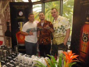 Rum sponsors offer free samples and cocktails all weekend in booths a the Tiki Treasures Bazaar. At The Hukilau 2016, Don Q reps included Alexx Mouzouris (center), named international rum brand ambassador of the year at the Golden Rum Barrel Awards during the UK RumFest in October. (Atomic Grog photo)