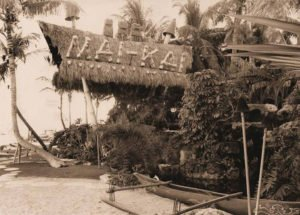 An early photo of The Mai-Kai's facade shows the three cannibal Tikis atop the restaurant sign. (Photo from Mai-Kai: History and Mystery of the Iconic Tiki Restaurant)