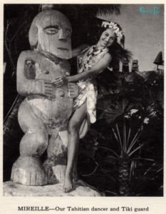 Mireille Thornton poses with the original Tiki that inspired Anders' carving in a photo from the 1963 Mai-Kai calendar, just a year after she became choreographer of the Polynesian Islander Revue.