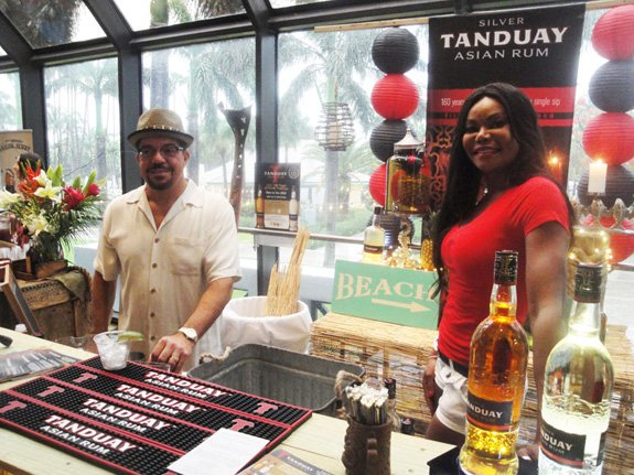 Tanduay Rum reps are happy to pour their gold and silver rums from the Philippines in cocktails for villagers to sample. (Photo by The Atomic Grog)