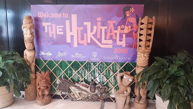 Villagers are greeted by a special sign and display in the lobby of Pier 66. Many of the Tikis are from the personal collection of artist Will Anders. (Photo by Hurricane Hayward / The Atomic Grog)
