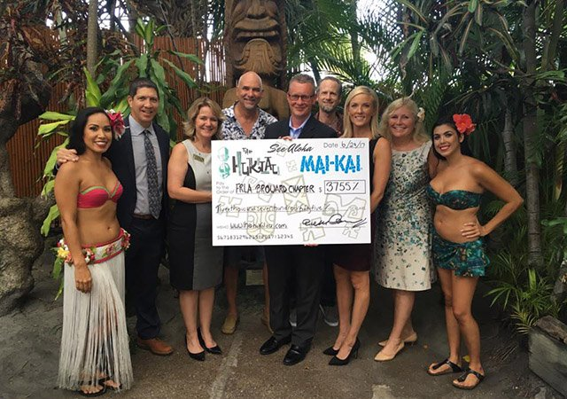 "Representatives of The Hukilau and The Mai-Kai present a check from the ""See Aloha"" charity efforts to the Florida Restaurant & Lodging Association on June 29 in The Mai-Kai's outdoor gardens. (Atomic Grog photo)"