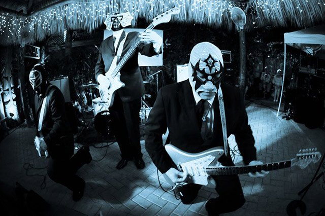 Los Straitjackets perform in Fort Lauderdale during The Hukilau 2009. (Photo by Go11Events.com)