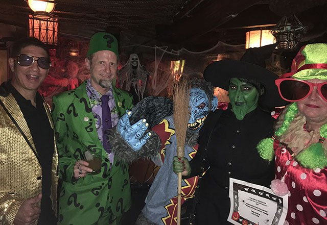 Hulaween 2017: The Evil Monkey and Wicked Witch accept their best costume award and prizes from The Mai-Kai's Kern Mattei (aka Elvis), The Atomic Grog's Hurricane Hayward (The Tiki Riddler), and The Mai-Kai's Pia Dahlquist (the kooky clown).