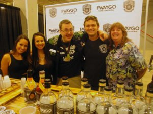 Avi Aisenberg and his team from Fort Lauderdale's award-winning Fwaygo Rum are welcomed by Rum Renaissance Festival producers Robin Burr and Rob V. Burr at the 2016 event. (Atomic Grog photo)
