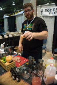 Ram Udwin, creator of the Boy Drinks World line of bitters, serves up tasty cocktails in his booth on the convention floor at the Rum Renaissance Festival in April 2017. (Atomic Grog photo)