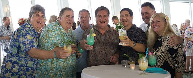 VIP villagers in attendance include (from left) Robert A. Burr of the Rum Renaissance Festival and Scott French (aka The Rum Trader), plus a crew from The Mai-Kai: John Gelardi, owner Dave Levy, manager Kern Mattei, Drew Daley), and marketing director Pia Dahlquist. (Atomic Grog photo)