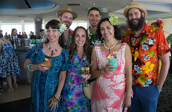 A spirited group of villagers enjoy their Tiki Tower Takeover cocktails. (Atomic Grog photo)