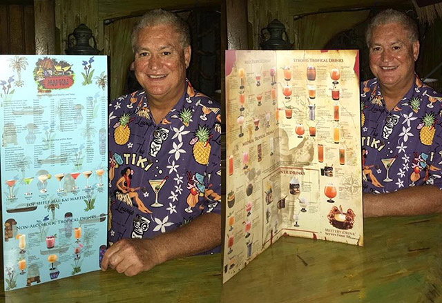 Owner Dave Levy shows off the new menu. (Facebook photo)