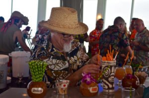 "Jeff ""Beachbum"" Berry serves up a signature Latitude 29 cocktail during the Tiki Tower Takeover event at Pier 66 in Fort Lauderdale during The Hukilau in June 2016. (Photo by Kevin Upthegrove)"