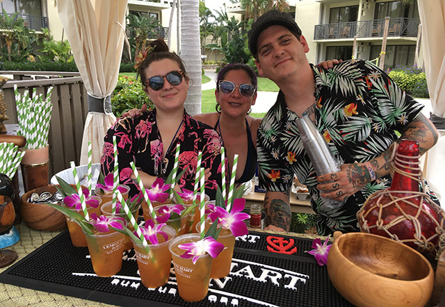 The crew from Delray Beach's Death Or Glory serve up signature drinks during a pool party. (Atomic Grog photo)