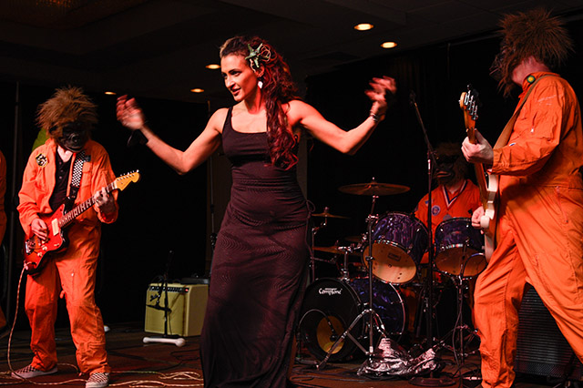Marina the Fire Eating Mermaid joins The Disasternauts on stage. (Photo by Heather McKean)