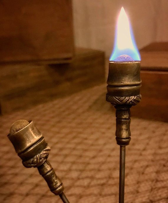 The Torch Swizzle is hand-sculpted by California artist Michael Grider. (Photo from GriderCo.Etsy.com)