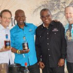 Alexandre Gabriel (left) of Maison Ferrand and Plantation Rum welcomed the team from Jamaica's Monymusk to share his booth as Hurricane Hayward (right) was excited to discover