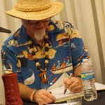 Beachbum Berry signs one of his six books on Tiki cocktails published over the past two decades