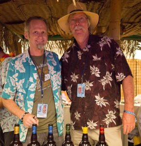 Veteran rum importer Ed Hamilton (right) offers Hurricane Hayward and other guests at The Hukilau a tasting of his full Ministry of Rum line of spirits in June 2018 in Fort Lauderdale. (Atomic Grog photo)