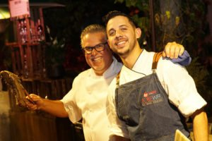 Among the many food booths at Art of Tiki is the one manned by acclaimed international restaurateur Richard Sandoval (left) and his executive cheft at Toro Toro in Miami, Jean Delgado.