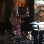 Amber Rutschmann on drums and triangle for The Surfrajettes during The Hukilau 2017 at The Mai-Kai in Fort Lauderdale