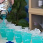 Brian Miller pours refreshing Blue Bayou cocktails at the Barbancourt Beach Club in the South Beach Wine & Food Festival's Grand Tasting Village on Saturday, Feb. 22, 2019
