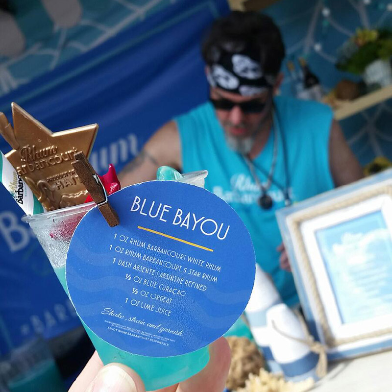 Brian Miller serves up a Blue Bayou at the Barbancourt Beach Club at the South Beach Wine & Food Festival on Saturday, Feb. 22, 2019