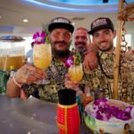 Daniele Dalla Pola (left) and his crew from Nu Lounge Bar in Italy (Emanuele Codispoti and Kevin Osbat) toast their second appearance at the Tiki Tower Takeover with the Kama'aina cocktail. (Photo by Hukilau Mike)