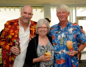 The Hukilau's Richard Oneslager (left) socalizes with Fort Lauderdale friends and Hukilau regulars Virginia Decker and Lonnie Dryden. (Photo by Heather McKean)