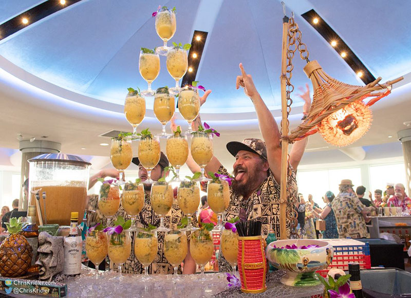 Daniele Dalla Pola of Nu Lounge Bar shows off his tower of Tiki cocktails at the Tiki Tower Takeover. (Photo by Chris Kridler)