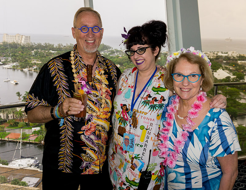 The Hukilau's busy organizer Sherill Gross (center) finds time to socialize with guests Jim and Eileen Neumayer. (Photo provided by Jim Neumayer)