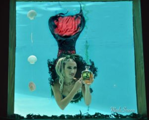 Marina the Fire Eating Mermaid endorses her favorite rum during a swimshow at The Hukilau 2016. (Provided by Medusirena)
