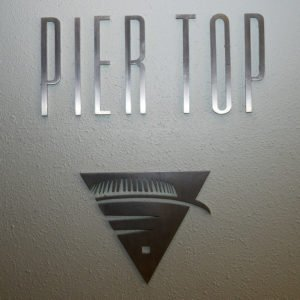 A sign at the top of the 17-story tower at Pier Sixty-Six in Fort Lauderdale before the first Tiki Tower Takeover in 2015. (Photo by Go11Events.com)