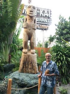 Will Anders with one of his massive carvings, Hiroa Nui, in the Tiki garden at The Mai-Kai in Fort Lauderdale. (Photo by Hurricane Hayward, May 2017)