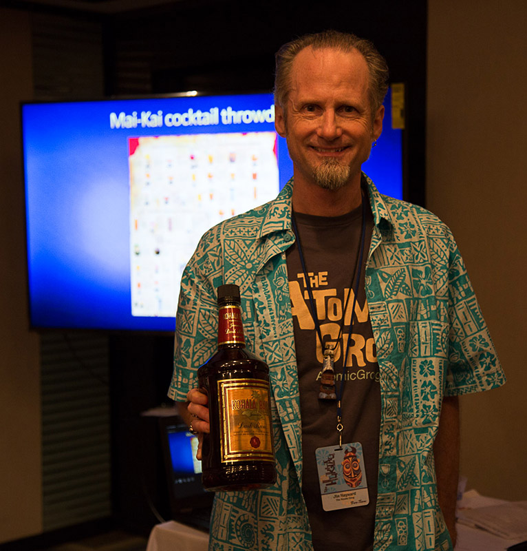 Hurricane Hayward reveals a bottle of the defunct Kohala Bay. A lucky student won it in a silent auction