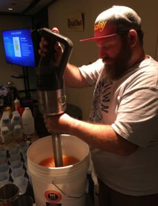 Lucky Munro, king of the giant immersion blender, batches up sample cocktail No. 3