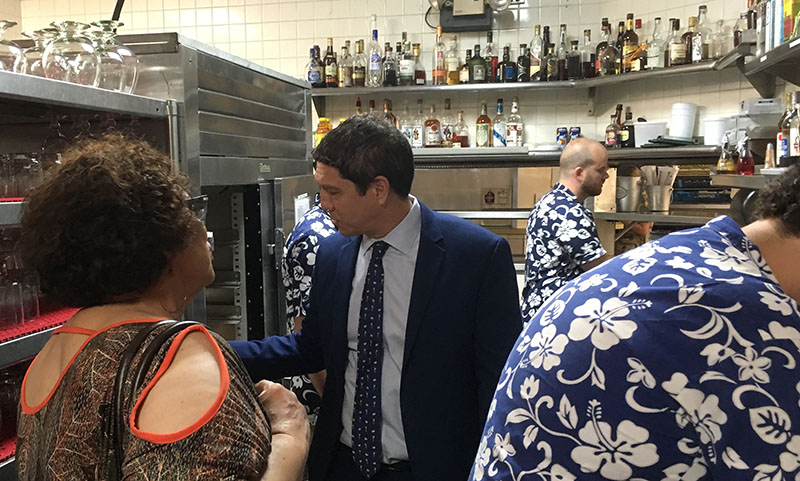 The Mai-Kai's manager, Kern Mattei, gives Appleton Estate master blender Joy Spence a tour of the busy back service bar and its collection of vintage rums, many dating back to the 1950s and beyond. (Photo by Hurricane Hayward, November 2018)