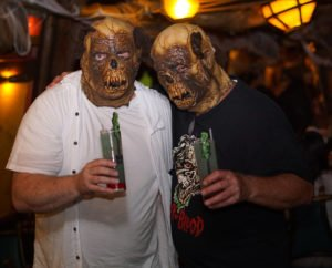 The Mai-Kai's owner, Dave Levy (right), shares a cocktail with David Sehring, owner of Drive-in Sanity Films and Hulaween sponsor. Sehring provided the special masks as part of a promotion for the release of a set of 1960s B-movie horror films.