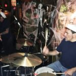 Slip and the Spinouts (bassist Rodney Simioni, guitarist/vocalist Slip Mahoney and drummer Mike Loschiavo) rock the house.