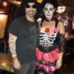 Hulaween welcomed Slash and a colorful friend.
